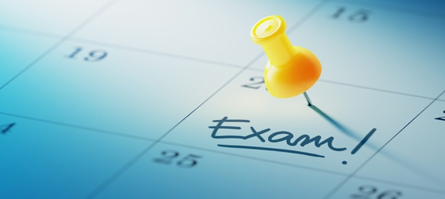 Calendar marked with exam and yellow pushpin