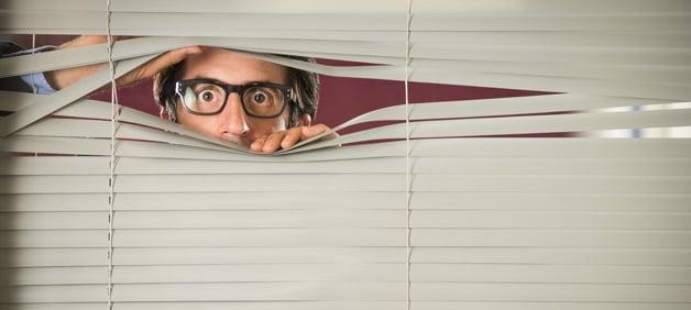 TESU-blog-man-fearful-peeking-through-blinds.jpg