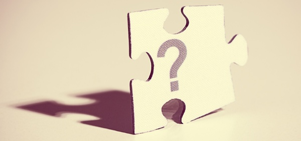 single puzzle piece with question mark
