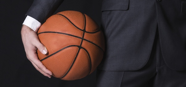 TESU blog_ accountant in a suit with basketball