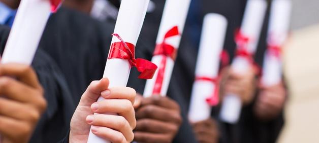 graduates-holding-college-diplomas.jpg