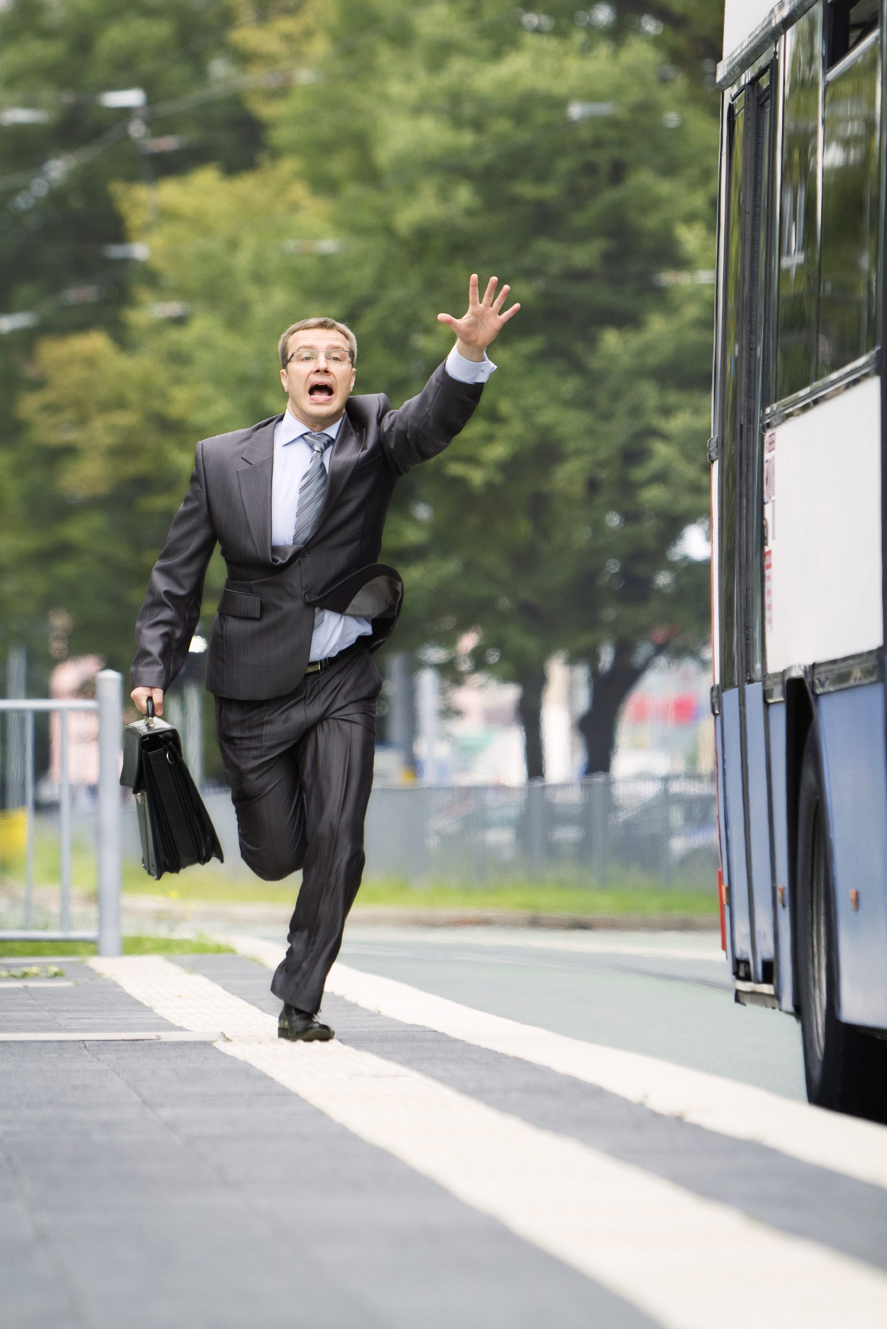 late business man running after bus