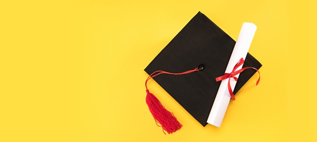 mortarboard-and-diploma-on-yellow-background.jpg