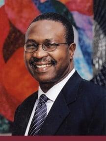 Dr. John O. Aje